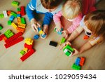 kids playing with plastic... | Shutterstock . vector #1029059434
