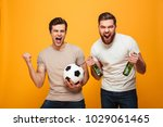 portrait of a two happy young... | Shutterstock . vector #1029061465
