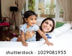 indian mother and daughter... | Shutterstock . vector #1029081955
