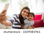smiling indian young woman... | Shutterstock . vector #1029081961