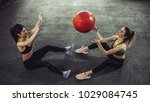 two females exercising with...   Shutterstock . vector #1029084745