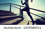 sporty female runner running... | Shutterstock . vector #1029086521