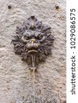 Small photo of Bard, Aosta Valley, Italy - July 29, 2017: Fountain shaped as a lion's head in the medieval village of Bard.