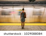 Young Woman Waiting For Subway...