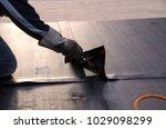 laying of waterproofing...   Shutterstock . vector #1029098299