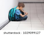 Sad Little Boy With Backpack...