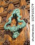 ancient engraved wooden  doors... | Shutterstock . vector #1029103279