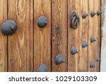 ancient engraved wooden  doors... | Shutterstock . vector #1029103309