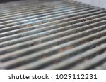 view on a rusty bbq grill | Shutterstock . vector #1029112231