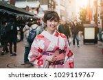 attractive asian woman wearing...   Shutterstock . vector #1029119767