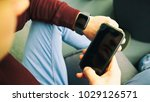 the guy is looking on his smart ... | Shutterstock . vector #1029126571