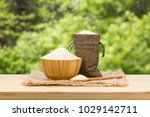 a bowl of rice on wooden table  ...   Shutterstock . vector #1029142711
