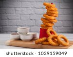Onion Rings And Sauces In Fron...
