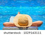 relaxation at tropical swimming ... | Shutterstock . vector #1029163111
