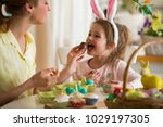 mother and daughter celebrating ... | Shutterstock . vector #1029197305
