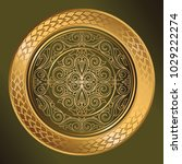 Golden ornate decorative emblem