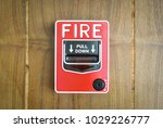 color fire alarm switch on wood ... | Shutterstock . vector #1029226777