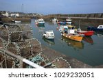The Still Tranquil Harbour At...