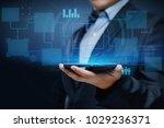 businessman pressing button.... | Shutterstock . vector #1029236371