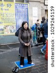 London, United Kingdom, 18th Febuary 2018:- Falun Gong members protesting during festivities to celebrate Chinese New Year in London's Chinatown area, for the year of the dog 2018 - stock photo