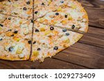 pizza with pineapple on a...   Shutterstock . vector #1029273409