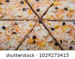 pizza with pineapple on a...   Shutterstock . vector #1029273415