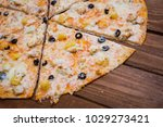 pizza with pineapple on a...   Shutterstock . vector #1029273421