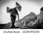 man walks up to the top of the... | Shutterstock . vector #1029293245