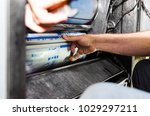 placing a print plate on four... | Shutterstock . vector #1029297211