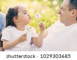 father and daughter blowing on... | Shutterstock . vector #1029303685