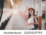 young female traveler with hat... | Shutterstock . vector #1029319795