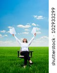young smiley woman with documents at the meadow - stock photo