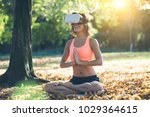young woman practicing yoga in... | Shutterstock . vector #1029364615
