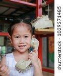 cute little asian child girl... | Shutterstock . vector #1029371485