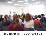speakers giving a talk at... | Shutterstock . vector #1029375595