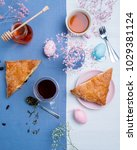 apple turnovers served with tea ...   Shutterstock . vector #1029381124