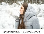 young woman winter portrait.... | Shutterstock . vector #1029382975