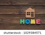 symbol of a house and colored... | Shutterstock . vector #1029384571