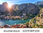 Small photo of Beautiful sunny cityscape, town of Omis on the banks of Cetina river, canyon and rocky Dinara mountains, top view from Mirabella (Peovica) fortress, mediterranean tourist resort in Dalmatia, Croatia