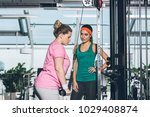 overweight woman working out on ... | Shutterstock . vector #1029408874