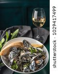 mussels in a white plate and a... | Shutterstock . vector #1029417499