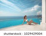 sexy model in white bikini... | Shutterstock . vector #1029429004