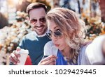 romantic couple sitting on the... | Shutterstock . vector #1029429445