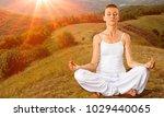 woman meditating in lotus pose | Shutterstock . vector #1029440065