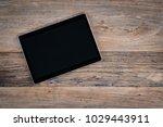 tablet computer on rustic...   Shutterstock . vector #1029443911