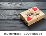 gift box wrapped in kraft paper ... | Shutterstock . vector #1029480835