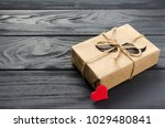 gift box wrapped in kraft paper ... | Shutterstock . vector #1029480841