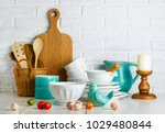 Stock photo kitchen still life with ceramic bird and easter eggs and utensils 1029480844