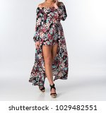 lovely woman in a print romper   Shutterstock . vector #1029482551