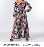 lovely woman in a print romper   Shutterstock . vector #1029482569